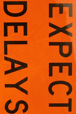 Expect Delays iPhone Wallpaper
