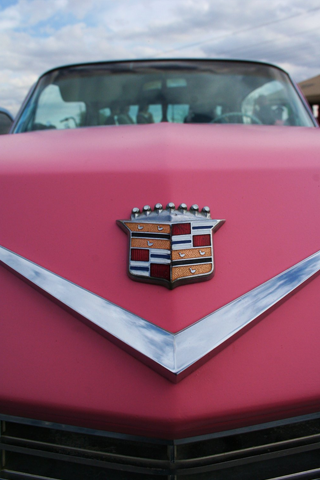 Pink Cadillac Emblem iPhone Wallpaper